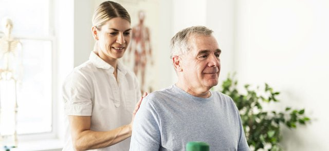 A Modern rehabilitation physiotherapy worker with senior client