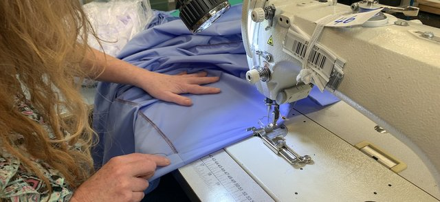 A reusable gown being made at Anze.jpg