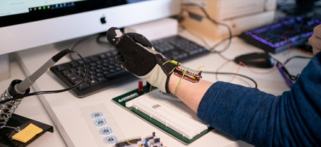 BioLiberty co-founder, Rowan Armstrong tests the glove (2).jpg